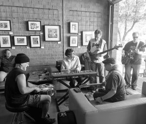 Five members of the blues band True Flavor Blues perform at Copper Star Coffee.