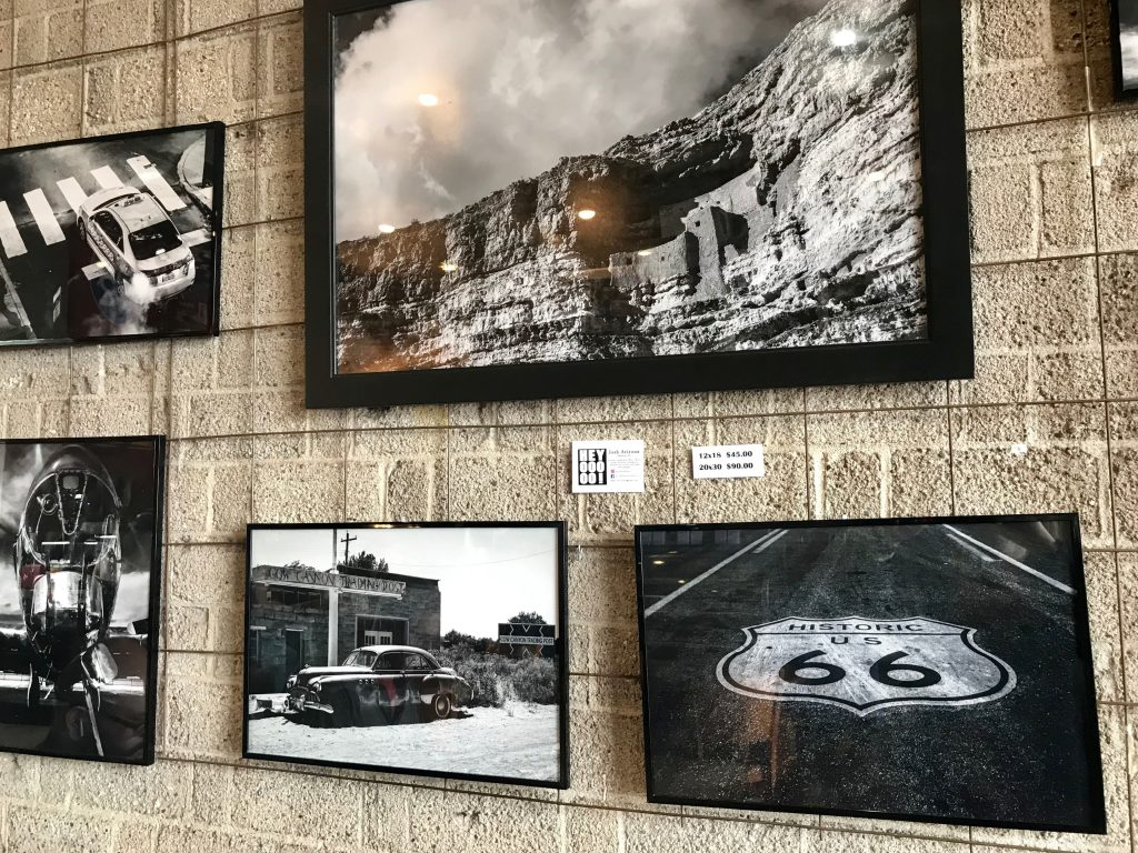 Framed photos of Route 66 and Arizona landscapes.